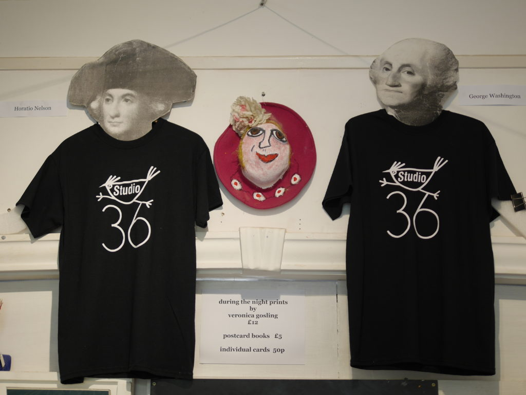 Our new T-shirts, modelled in the gallery by Horatio Nelson & George Washington!